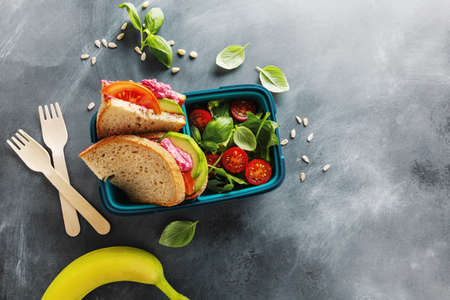 Tasty freshmade healthy vegan lunch to go served in lunch box. Closeup.