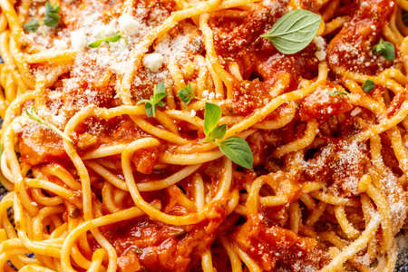 Tasty appetizing pasta with tomato sauce with cheese served on plate. Closeup. Standard-Bild