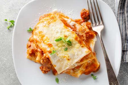 Tasty appetizing lasagna served on plate on table. Closeup Standard-Bild