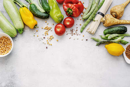 Tasty appetizing farm organic vegetables with healthy grocery on light background. Healthy eating concept. Top View