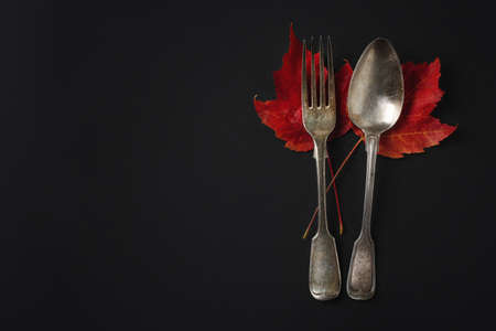 Vintage cutlery with autumn leaves on dark backrground. Flat Lay. Autumn concept. Stock fotó - 157774105