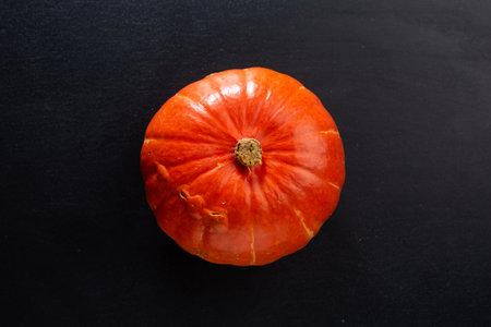 Whole pumpkin on dark background. Mockup. Closeup 免版税图像
