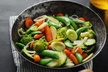 Vegan vegetables on pan fried or ready for cooking on table. Closeup. Selective focus 免版税图像
