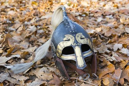 viking: Old forged Viking helmet on a leaf.