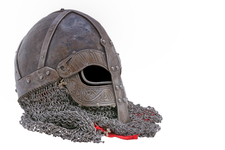 protective shield: Old forged Viking helmet on a white background. Stock Photo