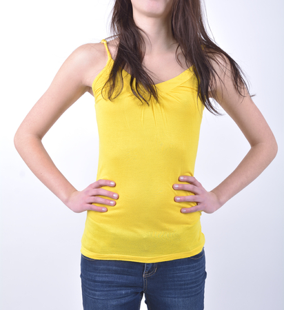 vest in isolated: Girl in a yellow vest isolated on white background Stock Photo