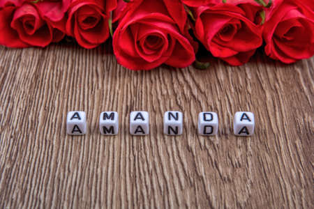 amanda: White cubes as a inscription Amanda on a wooden background Stock Photo