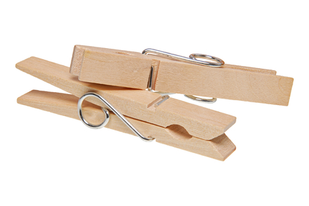 Wooden clothes pegs isolated on a white background Stock Photo
