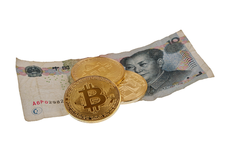Yuan china banknote and bitcoins isolated on a white background