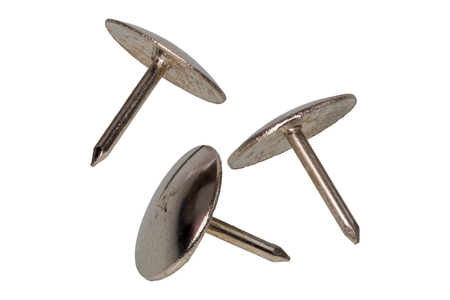 Group of metal thumb tacks isolated on a white background