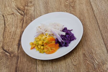 Chickpeas with carrot and leek, rice and buckwheat on a wooden table