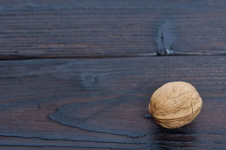 One walnut on a wooden table