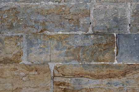 Old stone wall with scratches and cracks as texture 스톡 콘텐츠