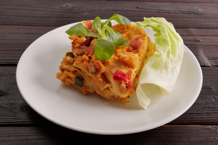 Lasagne with cauliflower on a wooden table Stock Photo