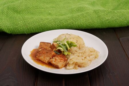 Tofu with cabbage and rice dumplings  on a wooden table Stock Photo