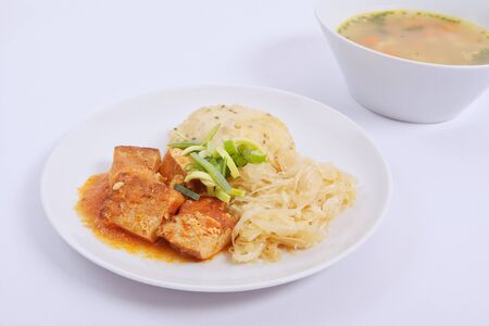 Tofu with cabbage and rice dumplings  on a white background Stock Photo