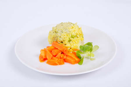 Rice with vegetables and herbs on a white background