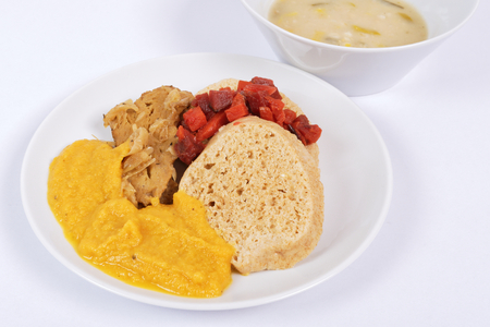 Sauce with seitan and dumplings on a on a white background