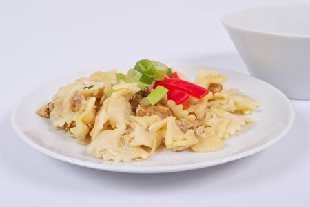 Wholemeal pasta baked with cabbage on a white background
