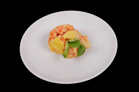 Cream potatoes with vegetables on a black background Standard-Bild