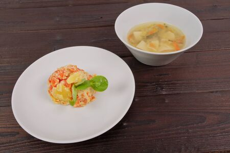 Cream potatoes with vegetables on a wooden table Standard-Bild