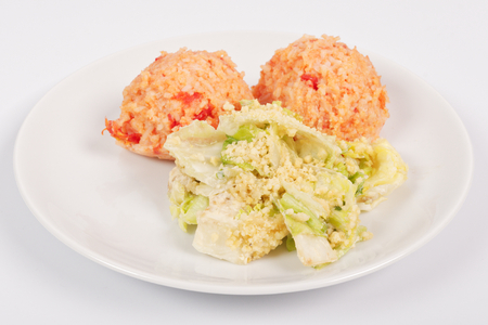 Tomato rice and salad on a white background