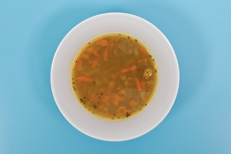 Lentil soup with carrots on a blue background