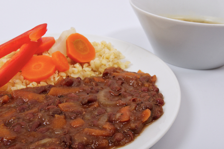 Azuki with vegetables on steam and bulgur on a white background