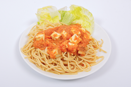 Bolognese spaghetti with tofu on a white background