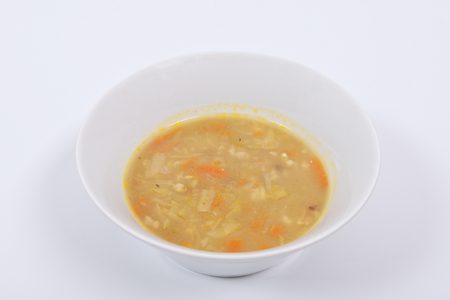 Soup with pasta and vegetables on a white background Stock Photo