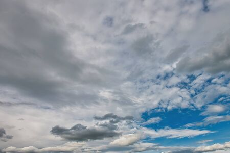 Blue sky background with white clouds. Beautiful nature wallpaper for background