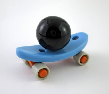 Little Skateboard Toy With Black Marble Ball On Yourself