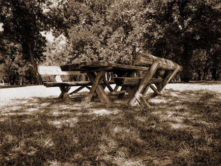 Old Picture Of Two Wooden Benches And A Table In The Forest. Horizontal Stock Image.