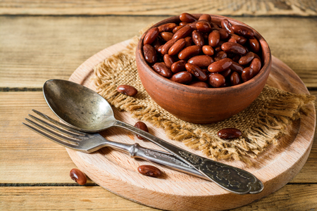 haricot: Boiled red beans in ceramic bowl. Selective focus. Stock Photo