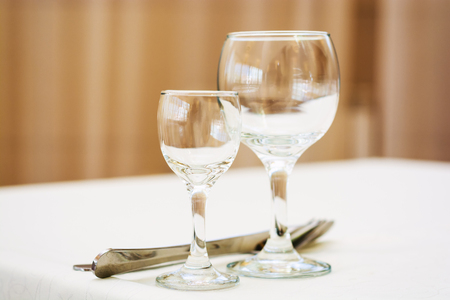 silver background: Empty wine glasses in restaurant. Selective focus.