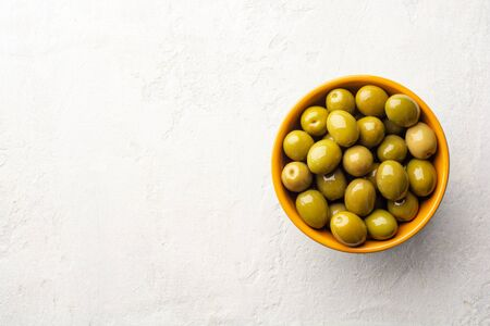 Green olives in ceramic bowl on concrete Reklamní fotografie