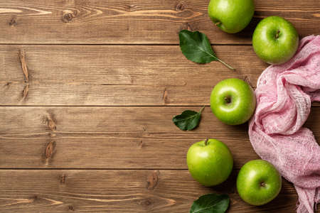 Fresh green apples on rustic wooden background. Top view, copy space. Reklamní fotografie