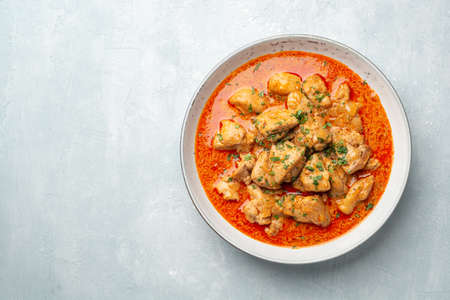 Chicken stew with paprika, onion and sour cream in plate Standard-Bild