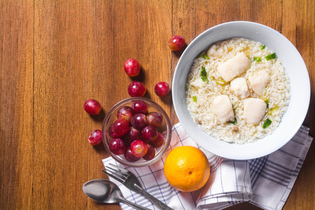 mush rice breakfast and mixed fresh fruits for healthy eating and dieting Stock Photo