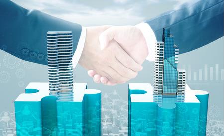 合併と買収ビジネス コンセプト、パズルのピースと握手、3 d のレンダリングに参加会社 写真素材