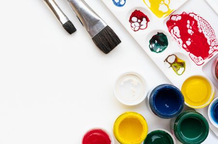Palette and  brush equipment for Color paint background Фото со стока