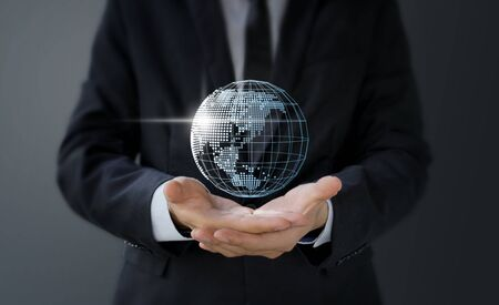 Businessman holding 3d digital world map in hand