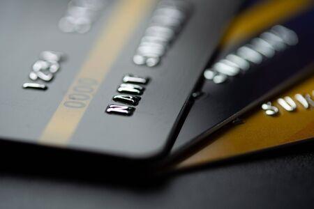 Close up black modern credit card business background Banco de Imagens