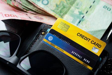 Close up credit card on black wallet background