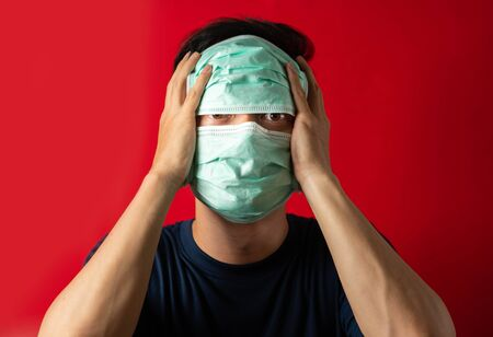 Sick man with mask touch head, fear virus Infect