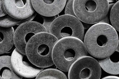 Stack of stainless steel washers, equipment for construction background