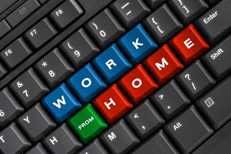 Work from home word on black keyboard, using computer online at home office Stock Photo