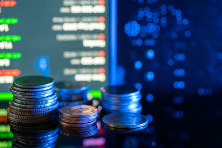Currency coins or money rate and stock market screen, economy and investment concept Stock Photo