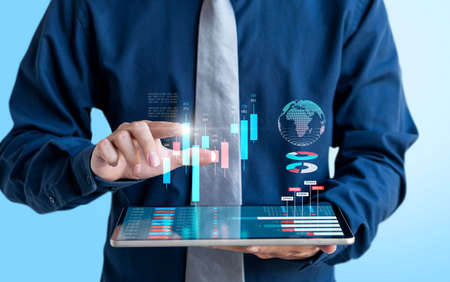 Businessman trading stock market and show modern graph chart on tablet screen