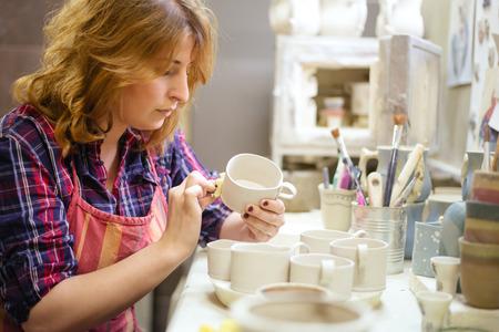 Pottery artist cutting edges